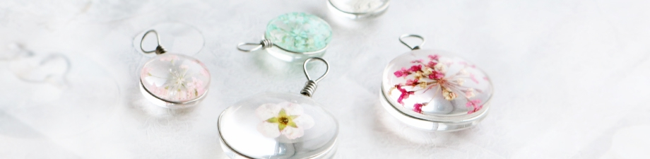 Charms with dried flowers and shell